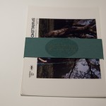 The photos and green paper band